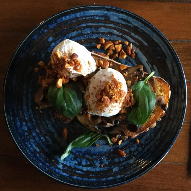 Portobello mushrooms on toast with poached eggs smoked almonds andhellip